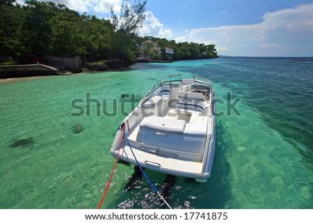 pleasure boat docked - stock photo