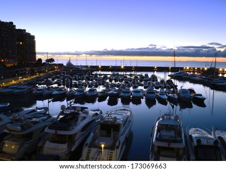 Pleasure boats in one of several harbours in Monaco during sunrise. - stock photo