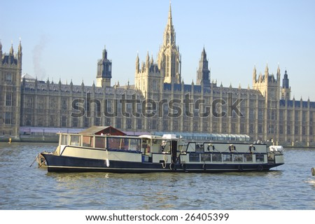 Pleasure cruiser on the River Thames in front of the Houses of Parliament, London, England - stock photo