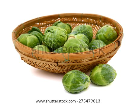 plenty of brussel sprout cabbages in basket isolated on white  - stock photo