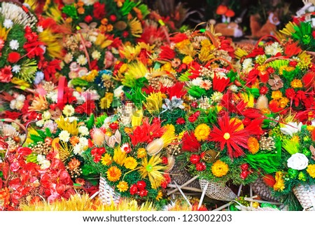 Plenty of different artificial flowers - stock photo