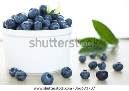 Plenty of fresh Blue berries in bowl - stock photo