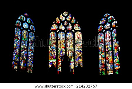 PLEYBEN, FRANCE - JULY 27, 2014: Stained glass windows with crucifixion and paradise scenes in Saint-Germain church in Pleyben. Parish enclosure in Pleyben is one of the most beautiful in Brittany. - stock photo
