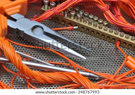 Pliers with electrical component kit  - stock photo