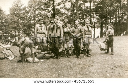 PLOCICZNO, POLAND, CIRCA 1957: Vintage photo of  group of scouts during a summer camp - stock photo