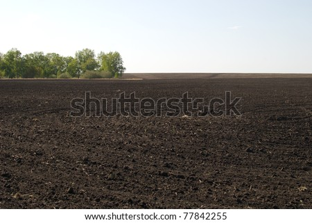 ploughed field and blue sky - stock photo