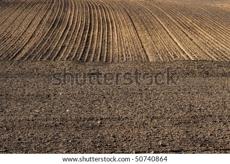 Plowed field ready for sewing. - stock photo