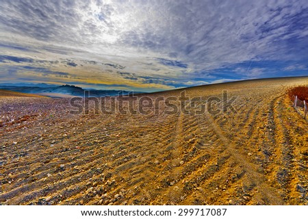 Plowed Sloping Hills of Spain in the Autumn at Sunset, Vintage Style Toned Picture - stock photo