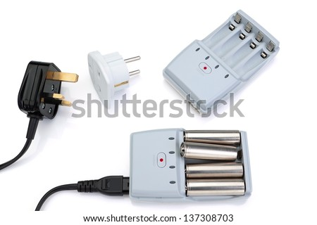 Plug adapter, charger and battery. On a white background. - stock photo