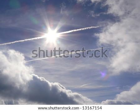 plugging sun in a blue sky - stock photo