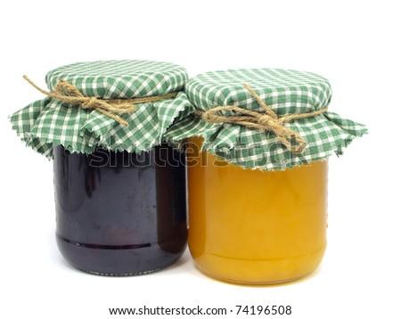 plum jam and honey in glass jars on white background - stock photo