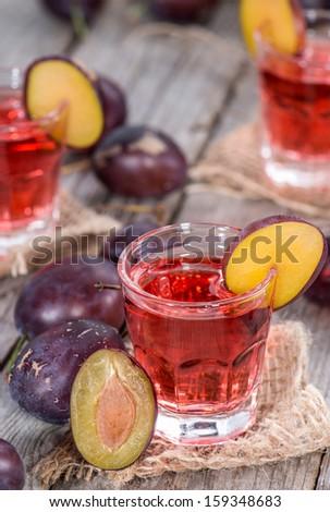 Plum Liqueur Shots in small glasses - stock photo