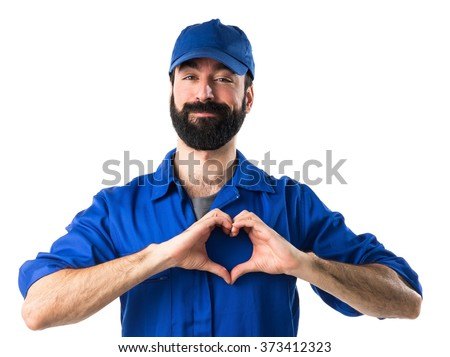 Plumber making a heart with his hands - stock photo
