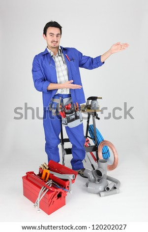 plumber showing with his hands - stock photo