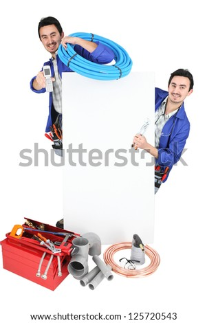 Plumber stood by advertising - stock photo