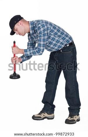 Plumber using plunger isolated on white background - stock photo