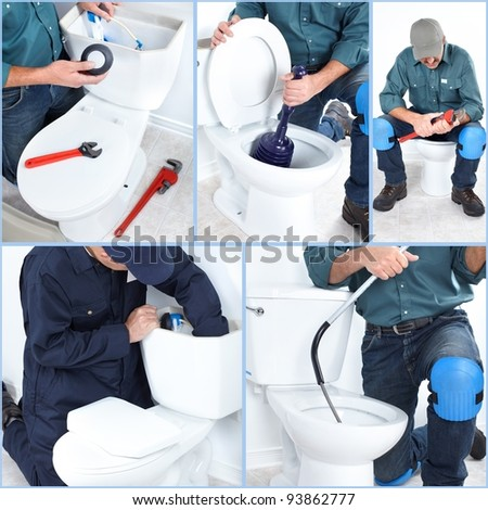 Plumber with a toilet plunger . - stock photo