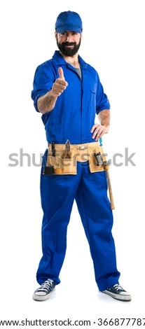 Plumber with thumb up - stock photo