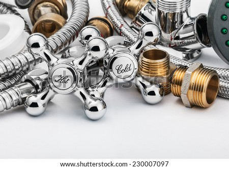 plumbing and tools on a light background - stock photo