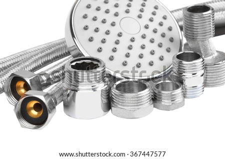 Plumbing fitting, hosepipe and showerhead, isolated on white background - stock photo