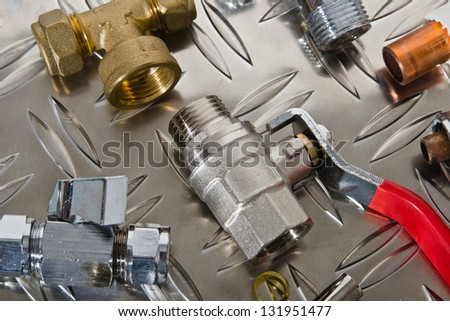 Plumbing inlet pipe valve on a metal surface - stock photo