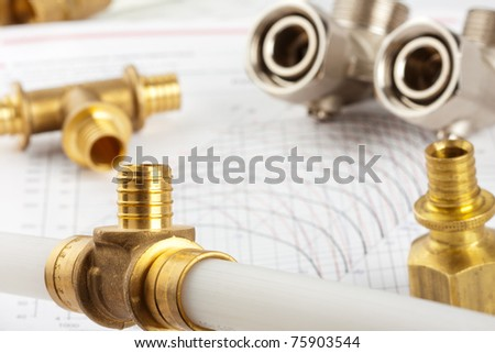 Plumbing supplies - pipes, accessories, documentation and valves - stock photo
