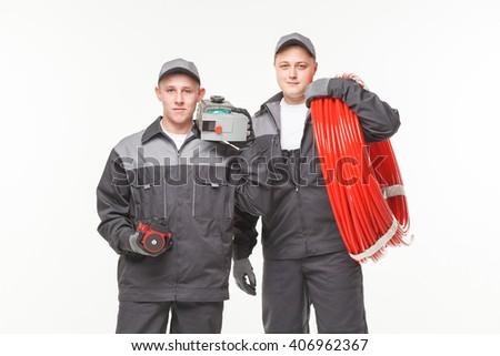 plumbing tools two man white background studio - stock photo