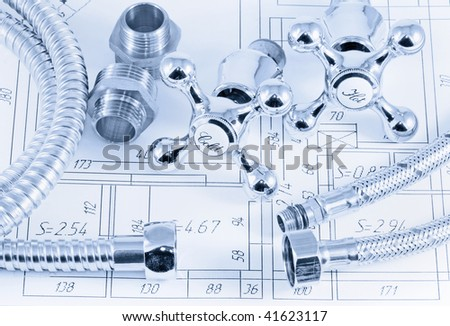 plumbing valves and hoses on the plan of the premises - stock photo