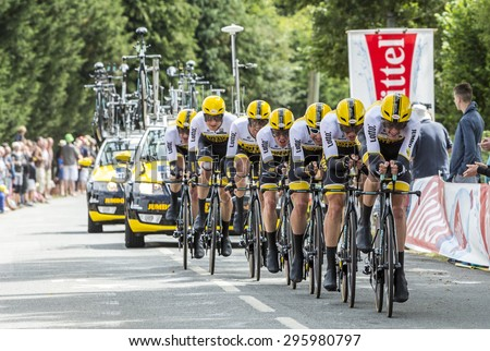 PLUMELEC,FRANCE - JUL 12:Team LottoNL Jumbo riding the Team Time Trial stage between Plumelec and Vannes, during Tour de France on 12 July, 2015. - stock photo
