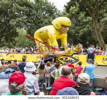 PLUMELEC, FRANCE - 12 JUL: The LCL yellow mascot during the passing of the Publicity Caravan before the Team Time Trial stage between Plumelec and Vannes, during Tour de France on 12 July, 2015. - stock photo
