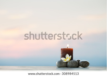 Plumeria flower, candle and stones for spa background  - stock photo