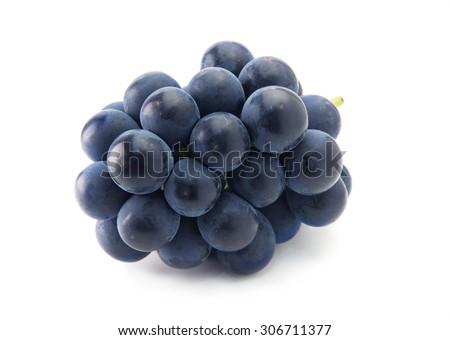 Plump Kyoho grapes (giant mountain grapes) isolated on white. - stock photo