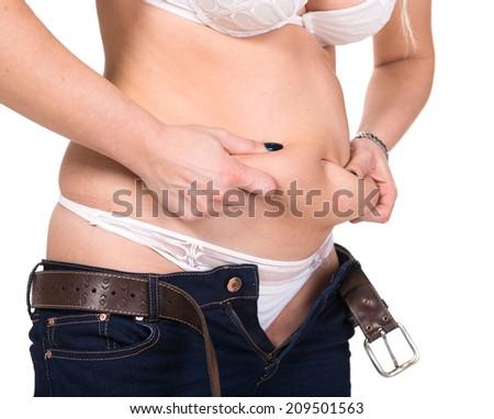 Plump woman pinching her fat tummy - stock photo
