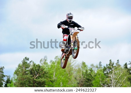 PLUNGE,LITHUANIA-MAY 11:Unidentified rider in action in Lithuanian Open Motocross Championship 2012 first roundon May 11,2012 in Plunge, Lithuania. - stock photo