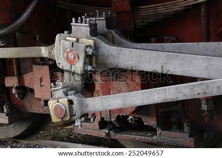 plungers of steam locomotive, closeup - stock photo