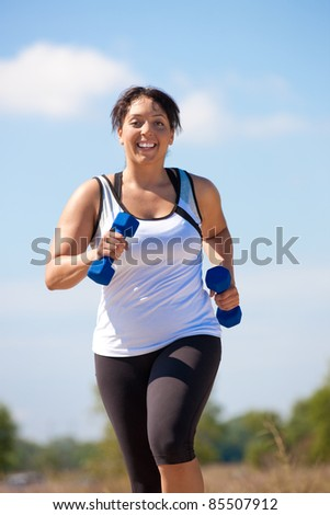 Plus Size Female Exercise Outdoor Happy Smile Under Sunny Blue Sky - stock photo