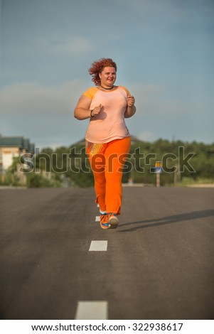 Plus size woman running, Healthy lifestyle - stock photo