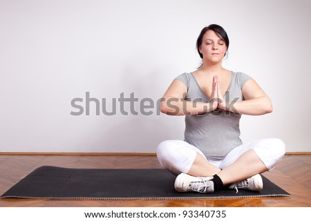 Plus sized woman in yoga position - stock photo