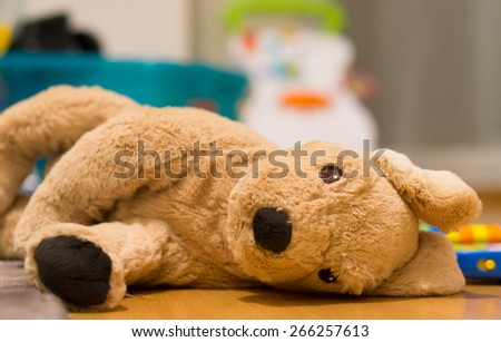 Plush dog lying on the floor - stock photo