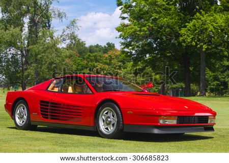 PLYMOUTH - JULY 26: A Ferrari Testarossa on display July 26, 2015 at the Councors D'Elegance in Plymouth, Michigan. - stock photo
