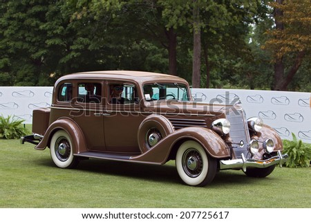 PLYMOUTH - JULY 27: A vintage automobile on display July 27, 2014 at the Concours D' Elegance Plymouth, Michigan. - stock photo