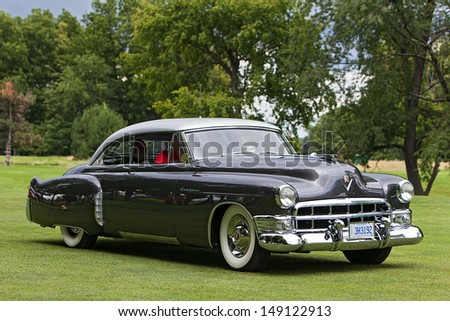 PLYMOUTH - JULY 28: A vintage Cadillac on display at the 2013 Concours D'Elegance  July 28, 2013 Plymouth, Michigan. - stock photo