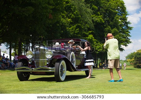 PLYMOUTH - JULY 26: An award is presented to a Duesenberg owner July 26, 2015 at the Councors D'Elegance in Plymouth, Michigan. - stock photo