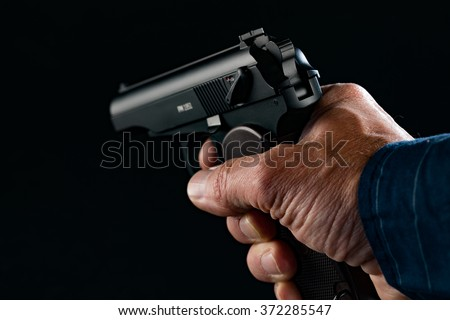 PM makarov Gun in man hand on black background - stock photo