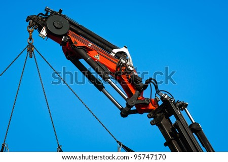 Pneumatic industrial crane against blue sky - stock photo