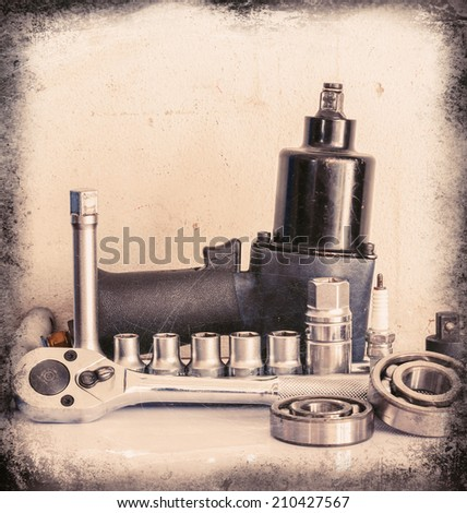 Pneumatic wrench, drive socket set, ball bearing, on over white, Vintage style - stock photo