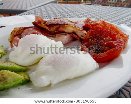 Poached Eggs with Bacon 3 - stock photo