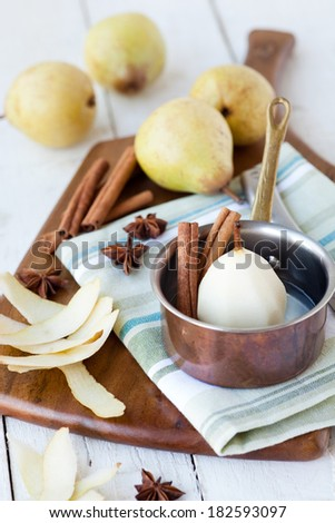 Poached Pear prep - shallow dof - stock photo