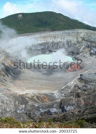 Poas Volcano Crater with steamy sulfur  mist, in Costa Rica - stock photo