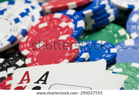 Pocket aces, and poker chips - stock photo